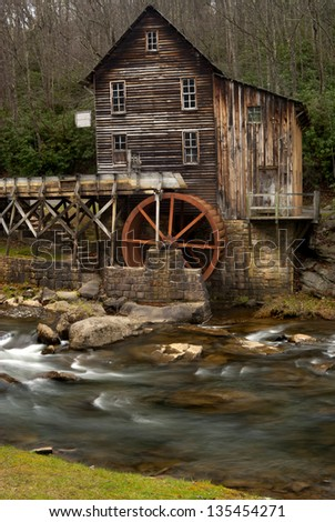 Glade Creek Grist Mill at Babcock State Park near New River Gorge in Fayette County, West Virginia taken in late fall. Long exposure with motion blur on water.
