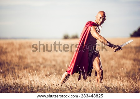 Gladiator, image of a well-built warrior  - stock photo