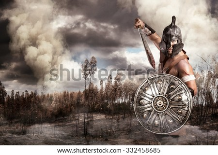 Gladiator in a battle site in the mountains - stock photo