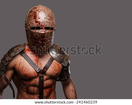 Gladiator in helmet with muscular body covered in blood