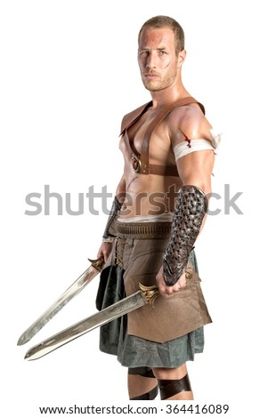 Gladiator posing isolated in a white background