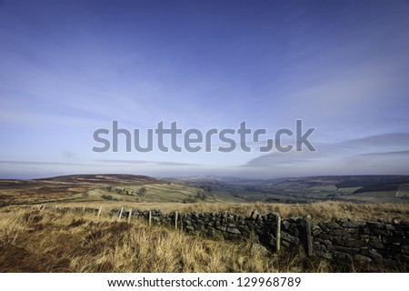 Glaisdale, Yorkshire, UK. Traditional stone farmhouse in the valley near Glaisdale in the heart of the North York Moors National Park on a bright sunny day. - stock photo