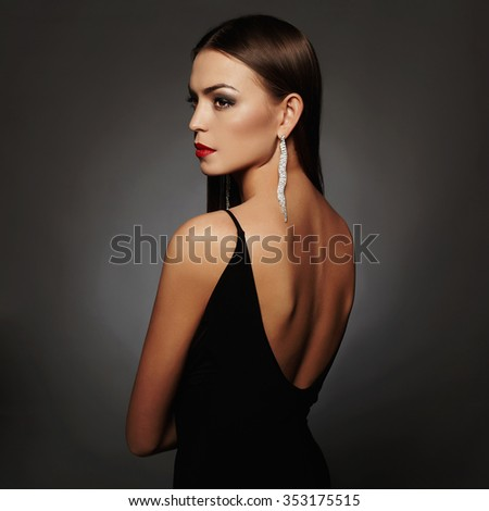 glamor beautiful young woman in a black sexy dress posing in the studio,luxury.beauty brunette girl - stock photo