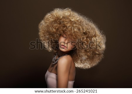 Glamor. Classy Gorgeous Woman with Curly Permed Hairs - stock photo
