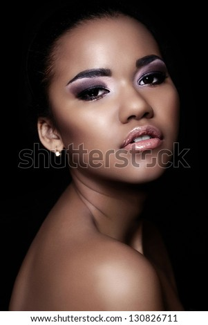 glamor closeup portrait of beautiful sexy black young woman model with bright makeup  with perfect clean  skin - stock photo