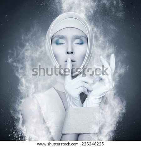 glamor portrait of a girl wrapped in a loop of the particles - stock photo