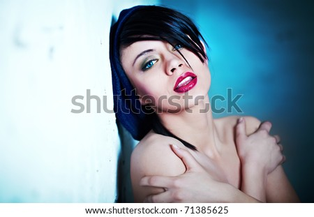 Glamor Portrait of sexy woman on blue background - stock photo