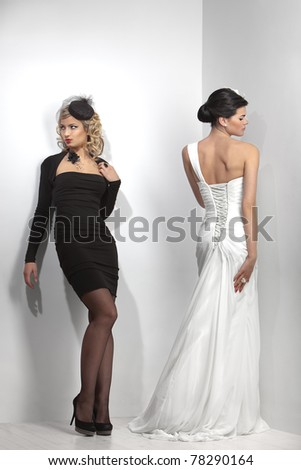 glamorous beauties in wedding and evening dresses - stock photo