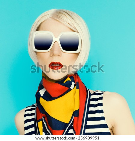 Glamorous blonde in fashionable Summer Accessory. Scarf with geometric pattern - stock photo
