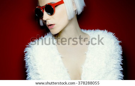Glamorous Blonde in fashionable Sunglasses.