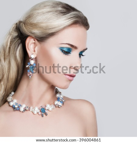 Glamorous Blonde Woman. Makeup and Hairstyle - stock photo