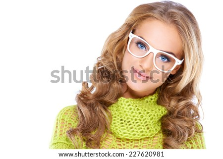 Glamorous blue eyed blond woman with long curly hair wearing glasses looking directly at the camera  head and shoulders on white - stock photo