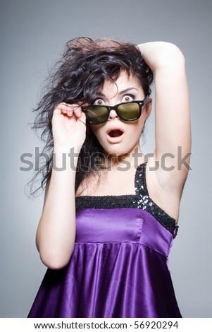 Glamorous brunette looking shocked - stock photo
