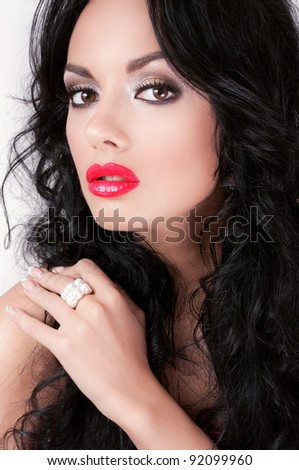 Glamorous brunette woman with red lips - stock photo