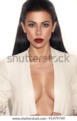 Glamorous busty woman with plunging neckline looking directly at camera, closeup on white - stock photo