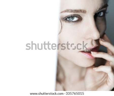 Glamorous fashion close-up portrait of a girl in a studio with a clean skin - stock photo