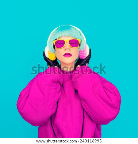 Glamorous fashion Girl in bright clothes listening to music. All shades of music art