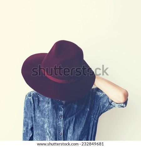 Glamorous Fashion Lady in a stylish denim shirt and hat. Vintage style - stock photo