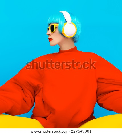 Glamorous Fashion Lady in bright clothes listening to Music. All Shades of Music - stock photo