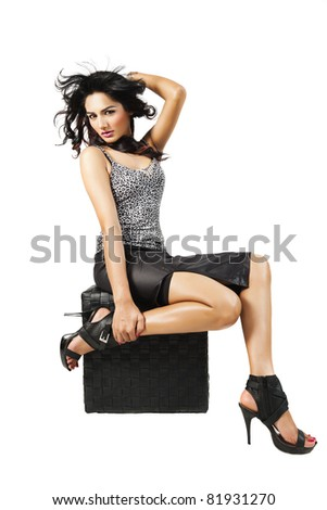 glamorous fashion model with long hair flying in the air, isolated on white. - stock photo
