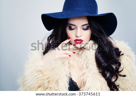 Glamorous Fashion Model Woman in Blue Hat - stock photo