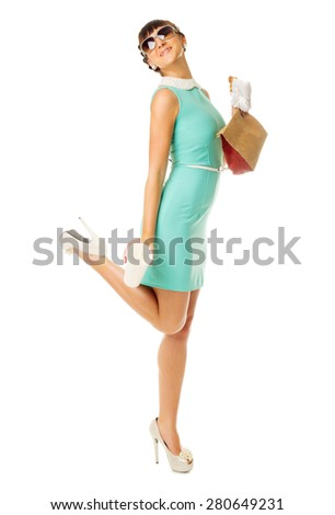 Glamorous girl in turquoise dress with snacks isolated - stock photo