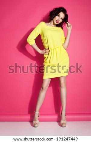 Glamorous girl wearing yellow dress, posing - stock photo