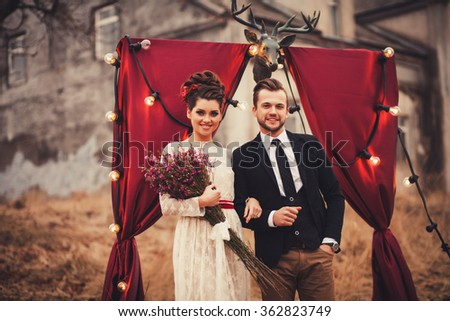 glamorous happy couple. woman in a lace dress, a man in a suit - stock photo