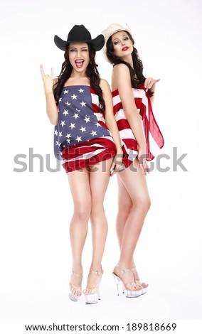 Glamorous Lucky Females in Hats and American Flag posing - stock photo