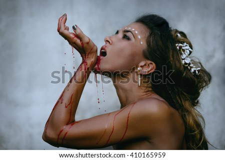 Glamorous photos of wild woman showing blood and gore dripping from the mouth