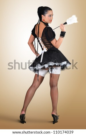 Glamorous pinup style french maid, cleaning concept - stock photo