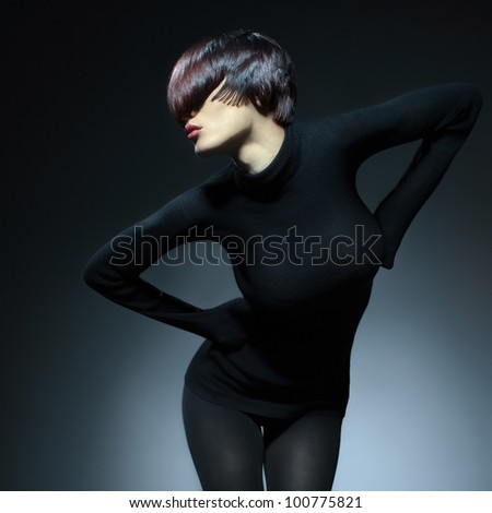 glamorous portrait of a beautiful woman with short hair fashion in black on a black background - stock photo