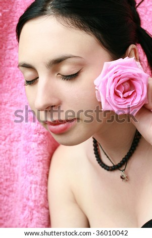 glamorous portrait of a girl with a rose