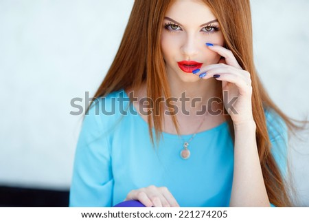 glamorous portrait of young beautiful woman in bright clothes. red lips. Summer portrait of a beautiful young Caucasian girl with red straight hair. fashion portrait. - stock photo