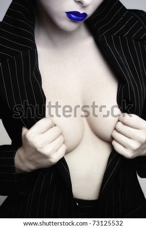 Glamorous shot of sexy woman torso in stylish black jacket - stock photo