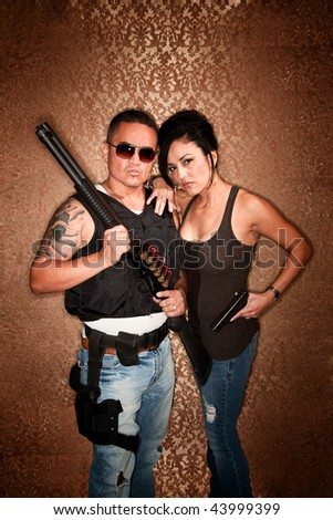 Glamorous Undercover Cops or Criminals with Shotgun and other Firearms - stock photo