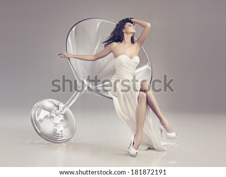 glamorous woman in a martini glass - stock photo
