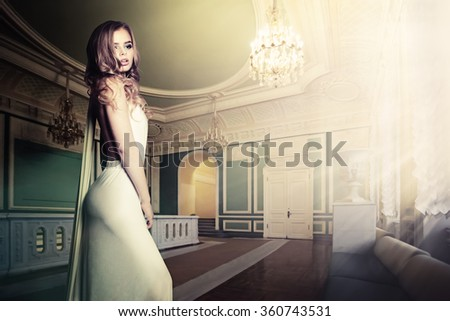 Glamorous Woman in Palace Interior - stock photo