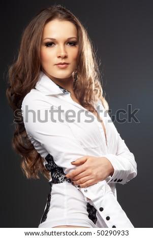 Glamorous woman in white jacket on a black background - stock photo