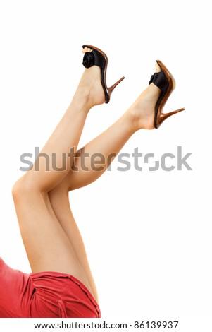 Glamorous woman legs on white - stock photo