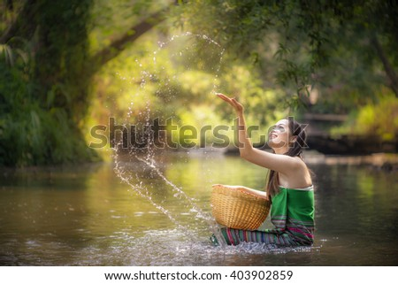 Glamorous woman showering in natural streams