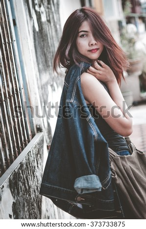 Glamorous young sexy woman in city location, Color effect image - stock photo