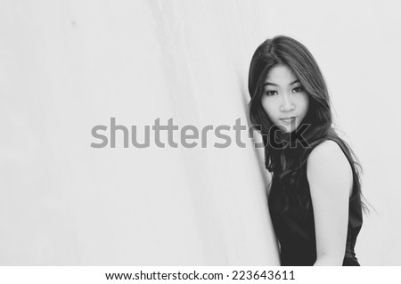 Glamorous young sexy woman in dress on white background, Black & White image - stock photo