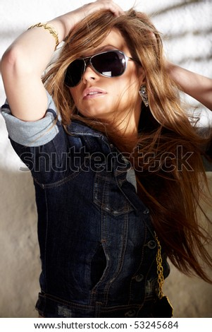 Glamorous young sexy woman in sunglasses - stock photo