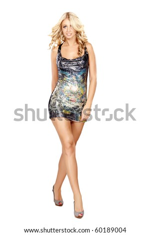 Glamorous young woman in short dress on white background - stock photo