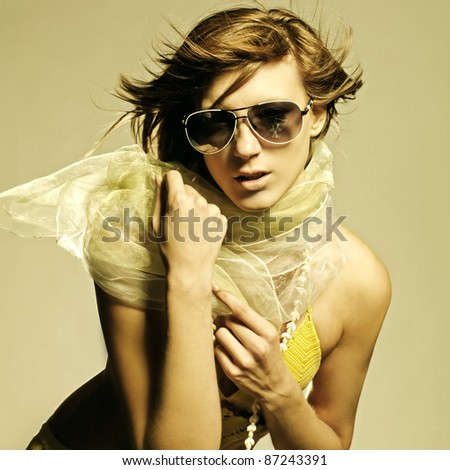 Glamorous young woman in sunglasses - stock photo