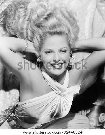 Glamorous young woman is happy and confident - stock photo