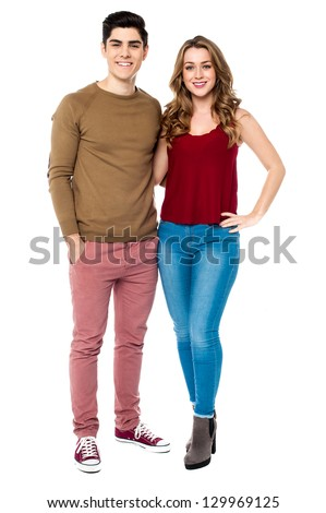 Glamorous young woman posing with her boyfriend over white background. - stock photo