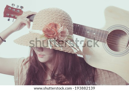 Glamorous young woman with her guitar on a white background, Retro effect - stock photo