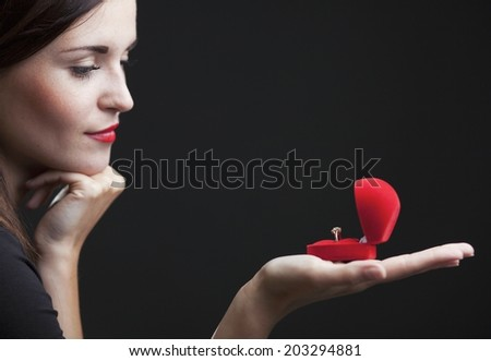 Glamour beautiful woman with engagement ring - stock photo